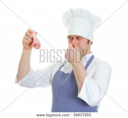 Chef Cook Holding Rotten Chicken Leg. Isolated On White