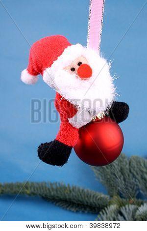 Santa Claus en la bola del árbol de Navidad