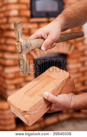 Mason Hands With Brick And Hammer