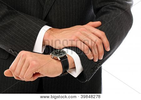 Close Up of businessman hands checking his watches over a white background