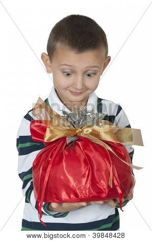 happy little boy holding the gift
