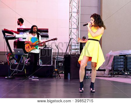 Beautiful girl in yellow dress singing