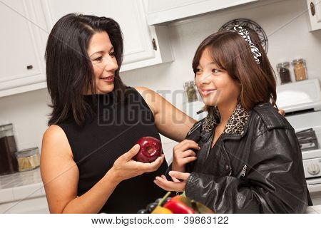 Pretty Hispanic Girl and Mother Getting Ready for School in the Kitchen.