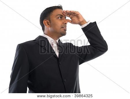 Young Asian Indian business male shielding his eyes and looking away, isolated on white background