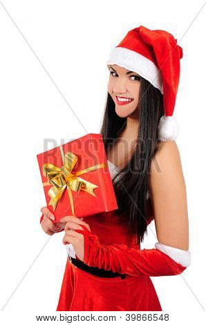 Isolated young brunette christmas girl holding gift