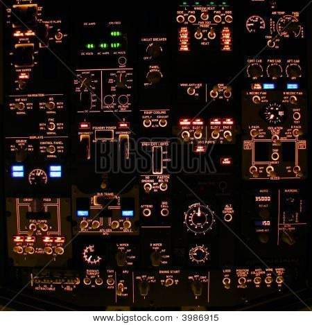 Flight Deck Overhead Panel Of A Modern Airliner At Night.