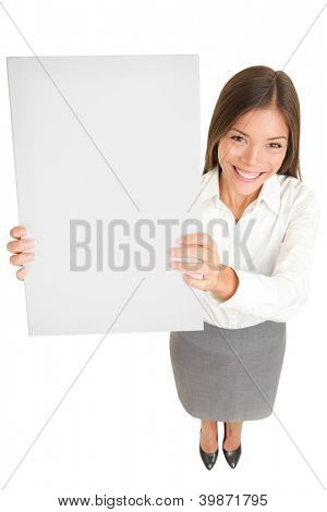 Businesswoman banner. High angle full length portrait of a beautiful smiling Asian businesswoman holding up a blank sign with copyspace for your text or advertisement isolated on white background.