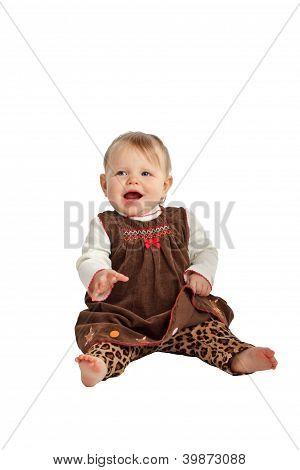 Cute Laughing Baby In Brown Velvet Dress