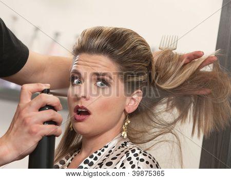 Stylist Uses Hairspray On Surprised Woman