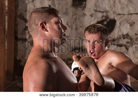 Young Kick Boxer In Action