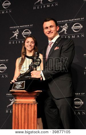 NEW YORK-DEC 8: Texas A&M quarterback Johnny Manziel, winner of the 2012 Heisman trophy, stands with Zoe Alaniz of W.B. Ray high school at the Marriott Marquis on December 8, 2012 in New York City.