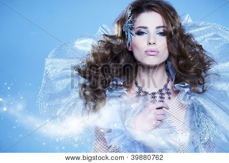 Young woman in creative image with silver artistic make-up.