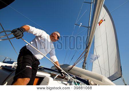 "SARONIC GULF, GREECE - SEPTEMBER 26: Unidentified sailor participates in sailing regatta ""Viva Greece 2012"" on September 26, 2012 on Saronic Gulf, Greece."
