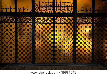 Decorative metal grating on window