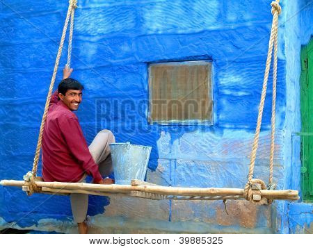 JODHPUR - OCTOBER 29. Indian man painting his house in blue on October 29, 2004 in Jodhpur, India. Jodhpur is famously known as the blue city.