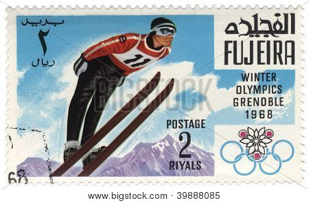 Ski Jumper At The Winter Olympics In Grenoble On Postage Stamp