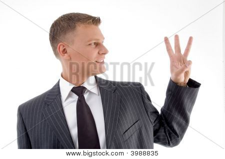 Happy Businessman Counting Fingers