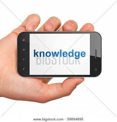Hand holding smartphone with word knowledge on display. Generic