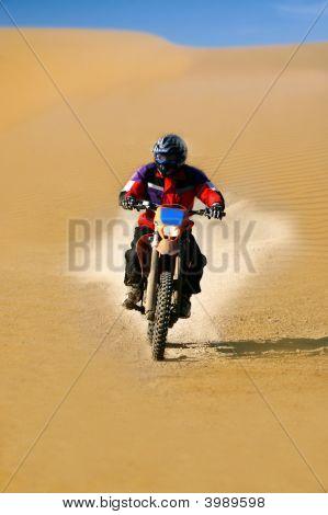 Moto Racer En Route In Desert