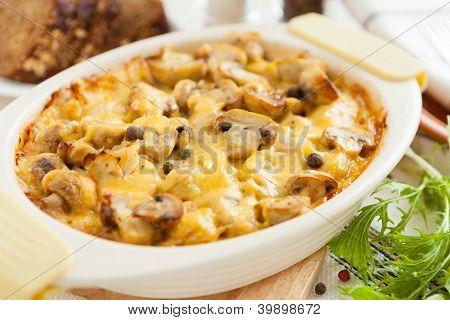 Baked Mushrooms, Potatoes And Cheese Closeup