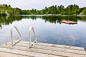 image of dock a lake  - Dock and ladder on summer lake with diving platform in Ontario Canada - JPG