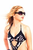 stock photo of monokini  - Portrait of young attractive woman in swimsuit with sunglasses isolated on white background - JPG