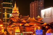picture of buddhist  - Golden Temples Roof Top Jing An Tranquility TempleCentral Shanghai China - JPG