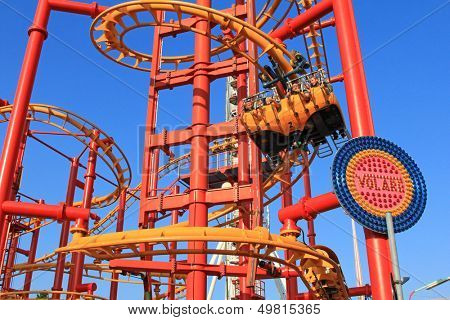 VIENNA - AUGUST 10 : Volare, the flying coaster at Wiener Prater Amusement Park on August 10, 2012 in Vienna. The coaster track is 420m. long, the height is 23m. People lay on stomach while flying.