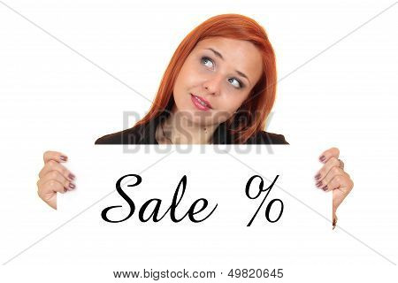 Sale. Portrait of a beautiful young woman holding up white banner