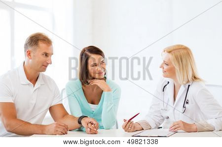 healthcare and medical concept - doctor with patients in cabinet
