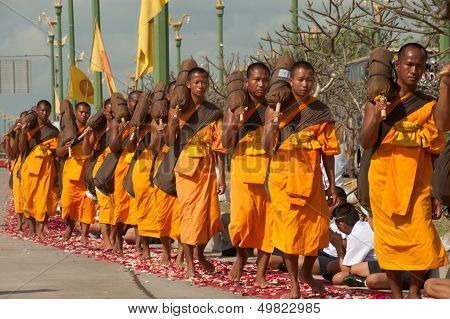 Row Of Buddhist Hike Monks On Street.