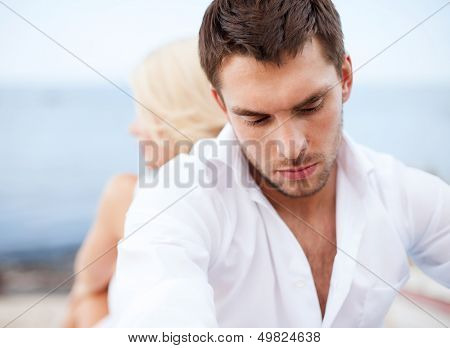 dating and relationships concept - stressed man with man outside