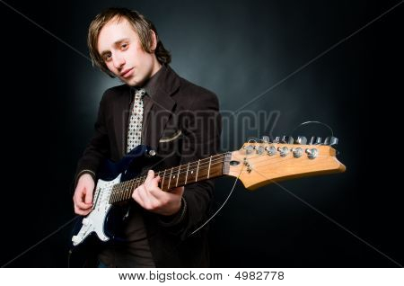 Handsome Man Playing Electro Guitar