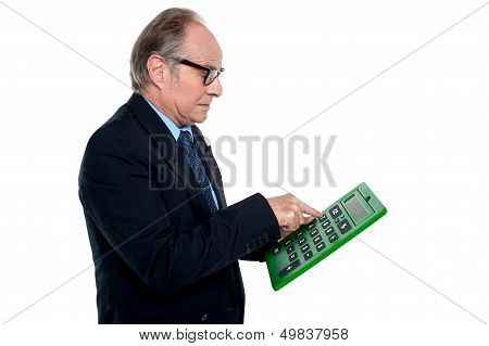 Intent Looking Executive Working On A Calculator