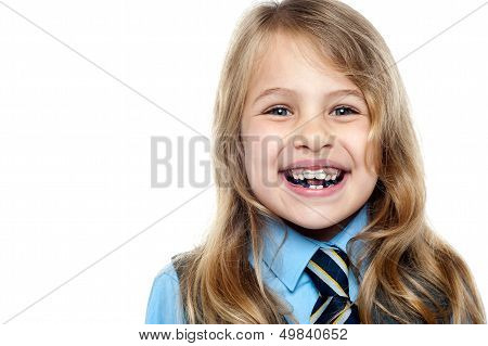 Face Closeup Of A Cheerful Young School Girl