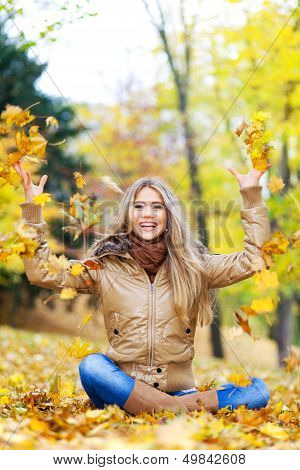 Happy Woman In Autumn
