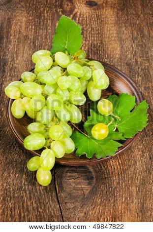 Green Grapes In A Clay Plate