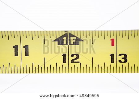 Tape measure in millimeters and inches isolated on white