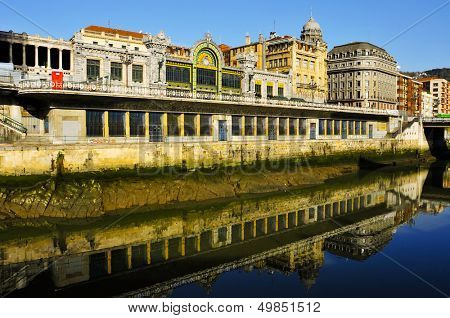 BILBAO, SPAIN - NOVEMBER 14: The estuary of Bilbao and FEVE station on November 14, 2012 in Bilbao, Spain. This station, built in 1902, was restored and renovated in 2007 to accommodate modern traffic
