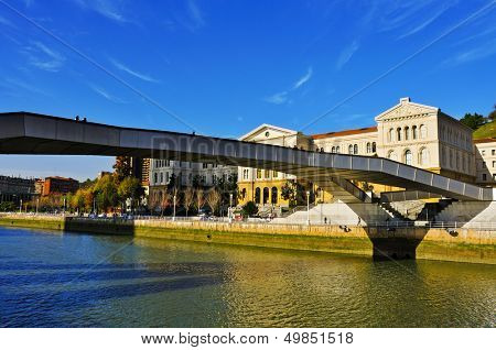 BILBAO, SPAIN - NOVEMBER 16: Pedro Arrupe Bridge over the estuary of Bilbao and the University of Deusto on November 16, 2012 in Bilbao, Spain. This footbridge, built in stainless steel, is 140 m long