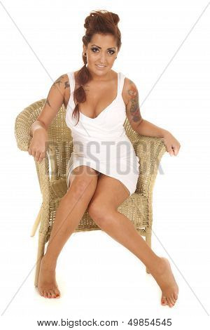 Woman Tattoos Sit Wicker Chair Facing Smile