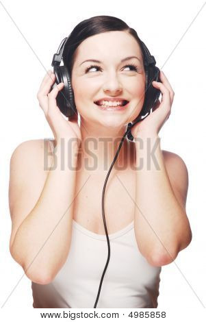 Smiling Girl Wearing Headphones And Looking To The Side