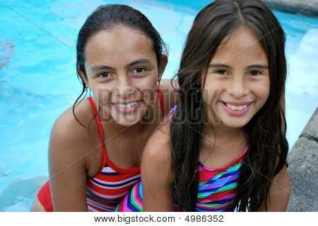 Beautiful Hispanic Girls By The Pool
