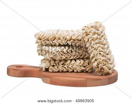Ramen Instant Raw Noodles On Cutting Board