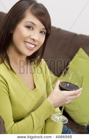 Oriental Woman Drinking Wine