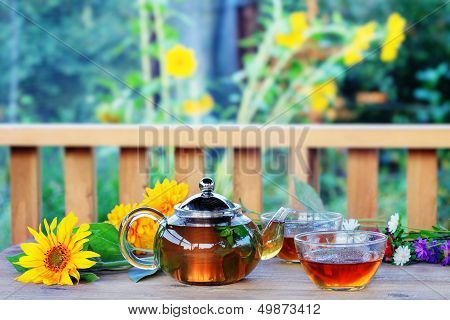 Herbal Tea In Teapot And Cup.