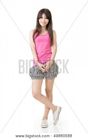 Young casual pretty asian woman in pink singlet ans striped shorts. Isolated on the white background.