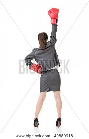 Young attractive asian business woman with boxing gloves are ready for battle. Rear view. Isolated on the white background.