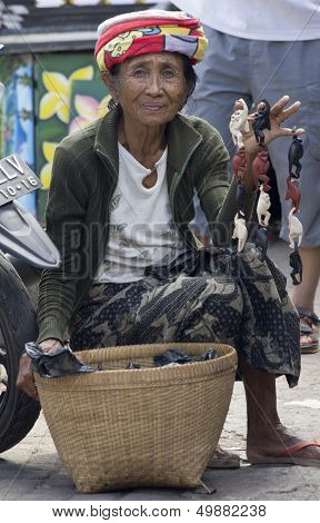 Bali, Indonesia-june 24Th: An Old Woman Selling Monkey Trinkets In Ubud On 24Th June 2012. Bali's Ol