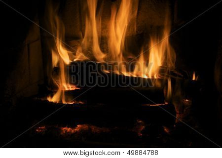 Cozy fire in fireplace